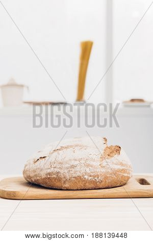 Fresh baked bread on a wooden table. soft light