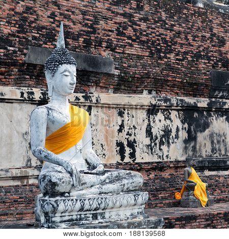 Ancient Buddha statues in Wat Yai Chaimongkol in Ayutthaya Thailand