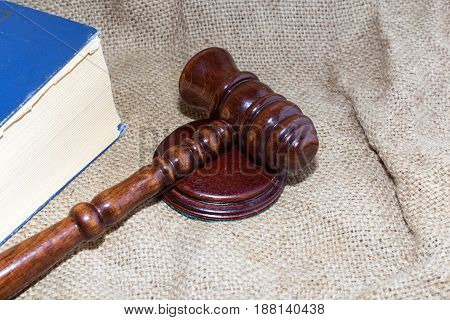 wooden gavel and book on the old bag.