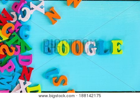 KIEV, UKRAINE - MAY 09, 2017: Google - word composed of small colored letters on blue background. Google is USA multinational corporation specializing in Internet-related services.