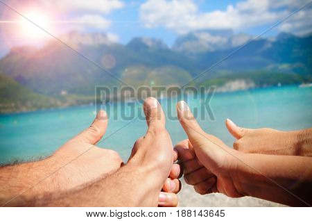 Funny Tourism Concept In The Sea With Fingers Upwards