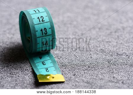 Tape For Measuring Of Cyan Color On Light Grey Background
