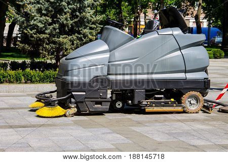 Street sweeper machine cleaning walkways in the park