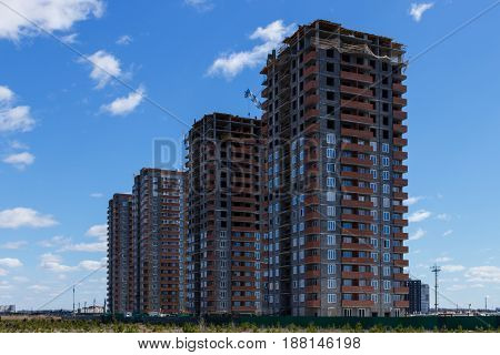 Construction of multi-storey houses balconies made of red brick
