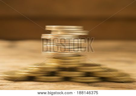 abstract blured of stack coins concept for money saving with growth business in the future.