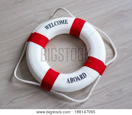 Red Lifebuoy With Welcome Aboard Text