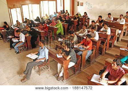 Students are sitting during lecture in class room while listening to teacher's lecture in University Of Karachi 25/09/2012