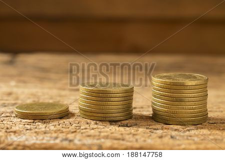 stack of coins image of gold coins step by step for money saving or saving growth
