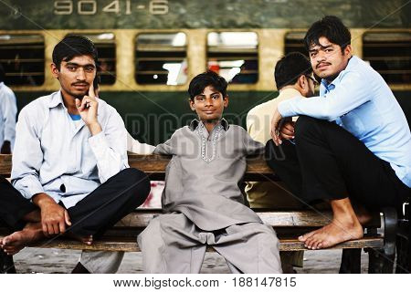 Passengers sitting on a bench and waiting for their train at Karachi Cantt Station - 17-03-2013
