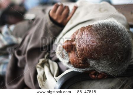 An old man sleeping on a bench at Karachi Cantt Station - 17-03-2013