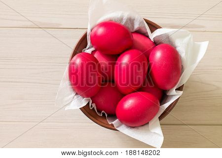 Ceramic bowl with red Easter eggs. Ukrainio tradition.