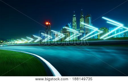 Motion blurred racetrack with city skyline background night scene cold mood. with arrow light Effects.
