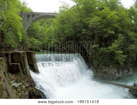 beautiful waterfall among green forest in Slovenia Blejski Vintgar