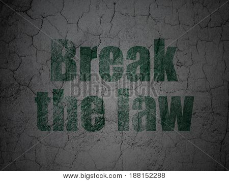 Law concept: Green Break The Law on grunge textured concrete wall background