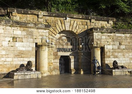 PYATIGORSK; RUSSIA - MAY 26; 2017:Spilled the famous underground hot mineral lake Proval.Monument of Ostap Bender at the entrance to Proval in Pyatigorsk; Northern Caucasus; Russia. (sculptor Ravil Yusupov; september 2008)