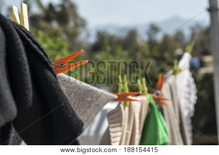Close up shot of clothes hanging on a clothesline