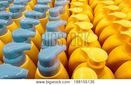 Color plastic bottles with lids in a row. Background.