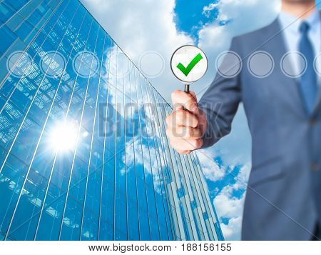 Businessman Magnifying Glass Check Mark On Virtual Screen. Magnifying Glass On A Checklist Box And T