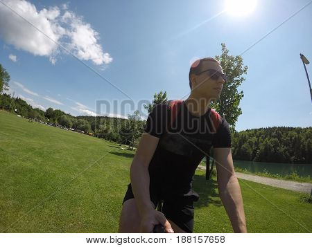 young man selfie on bicycle in countryside beautiful day