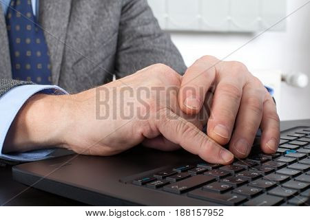 Close up picture of a businessman's hands when typing an e-mail