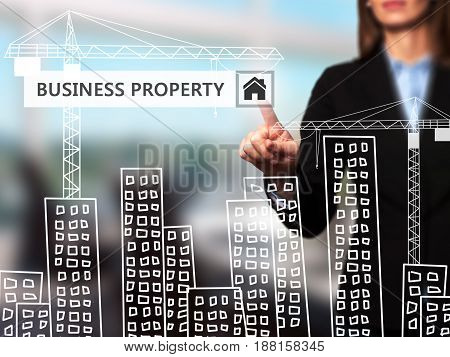 Businesswoman Pressing Business Property Button On Virtual Screens