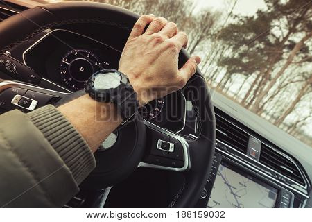 Driver Hand Holds Steering Wheel Of Crossover Car