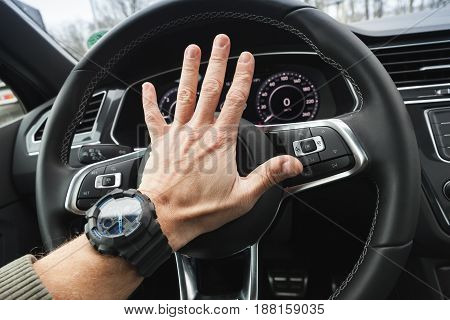 Driver Angry Pushes A Steering Wheel Klaxon