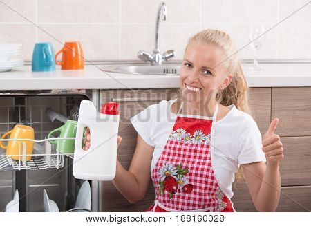 Woman Showing Detergent For Dishwasher
