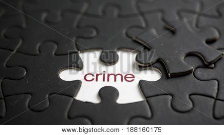 Word crime under black jigsaw puzzle piece