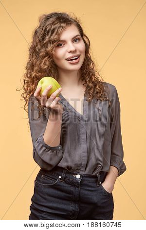 woman biege background curly hair blouse copy space