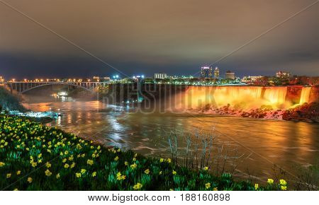 The American Falls and the Rainbow Bridge at Niagara Falls, Canada