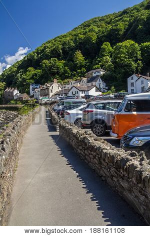 Lynmouth, Devon, England, 13 July 2016: The sidewalk along the river and parking in Lynmouth. North Devon. UK