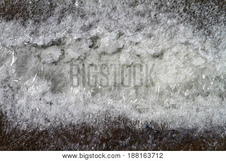 Sea salt crystals frozen on the ground