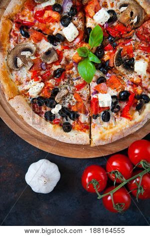 Hot Testy Pizza With Tomatoes, Mozzarella, Mushrooms, Olives, Red Pepper And Basil On Black Concrete