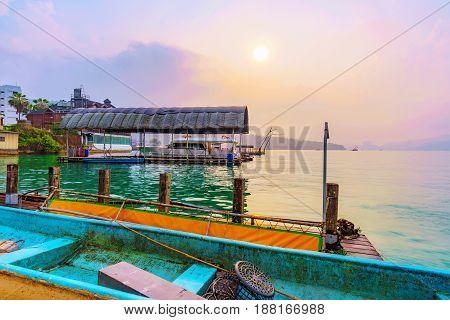Fishing boat with sunset on sun moon lake