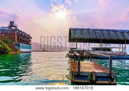 Wooden raft with sunset on Sun Moon Lake