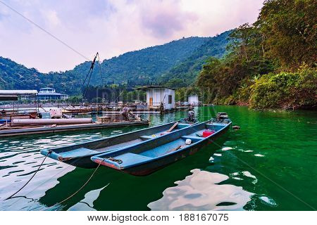 Fishing boats and nature on Sun Moon Lake in Taiwan