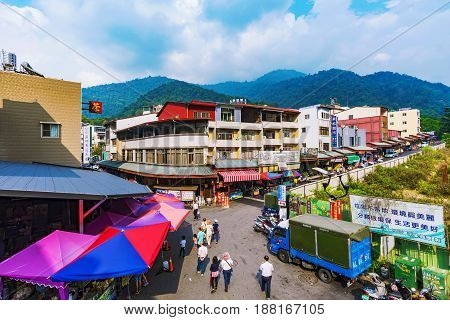 NANTOU TAIWAN - MAY 06: This is a small village with market vendors guesthouses and small hotels in Sun Moon lake where many tourists come to shop and stay on May 06 2017 in Nantou