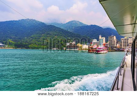 NANTOU TAIWAN - MAY 06: This is a view of a Harbor and mountains taken from a boat on Sun Moon Lake a popular tourist destination on May 06 2017 in Nantou