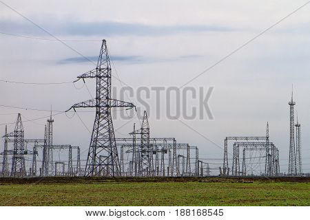 High voltage electric lines on a blue sky background