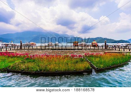 NANTOU TAIWAN - MAY 06: This is a scenic view of a harbor where tourists come to take boats to other parts of Sun Moon lake on May 06 2017 in Nantou