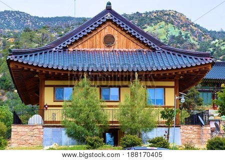 May 10, 2017 in Tehachapi, CA:  Temple building used for meditation surrounded by mountains creating a peaceful ambiance taken at the Taegosah Buddhist Monastery where people can visit daily and attend Sunday Services in Tehachapi, CA