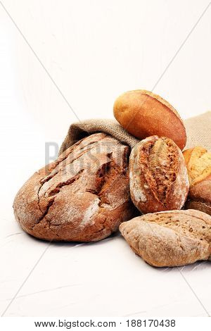 Different Kinds Of Bread And Bread Rolls On Board From Above. Ki