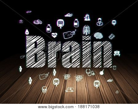 Healthcare concept: Glowing text Brain,  Hand Drawn Medicine Icons in grunge dark room with Wooden Floor, black background