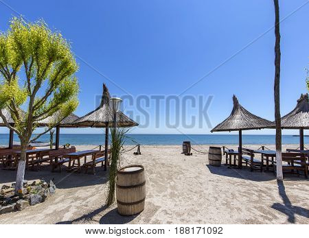 Wide sand beach with umbrellas on Black Sea in Romania