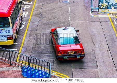 HONG KONG CHINA - APRIL 27: This is a view of a local taxi driving down a road in the busy Mong Kok area on April 27 2017 in Hong Kong
