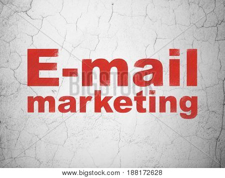 Marketing concept: Red E-mail Marketing on textured concrete wall background