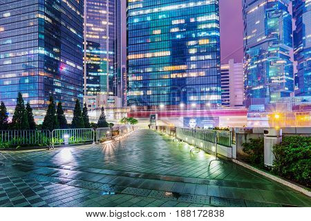 HONG KONG CHINA - APRIL 25: View of skyscrapers and a footbridge leading to Admiralty station in the financial district at night on April 25 2017 in Hong Kong