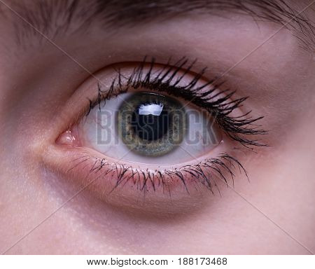 Teenage girl's eye on her young face