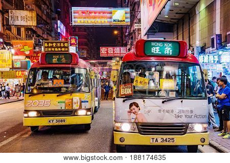 HONG KONG CHINA - APRIL 24: This is a night scene of local buses in the Mong Kok shopping district area which is a crowded busy area on April 24 2017 in Hong Kong